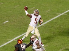 MIAMI GARDENS, FL - NOVEMBER 15: Jameis Winston #5 of the Florida State Seminoles throws the ball against the Miami Hurricanes during third quarter action on November 15, 2014 at Sun Life Stadium in Miami Gardens, Florida. The Seminoles defeated the Hurricanes 30-26. (Photo by Joel Auerbach/Getty Images)