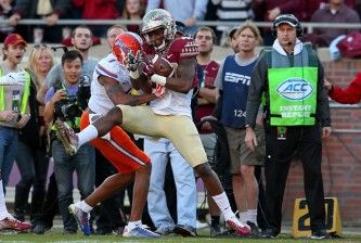 TALLAHASSEE, FL - NOVEMBER 29: Lamarcus Brutus #42 of the Florida State Seminoles catches an interception  during a game against the Florida Gators  at Doak Campbell Stadium on November 29, 2014 in Tallahassee, Florida.  (Photo by Mike Ehrmann/Getty Images)