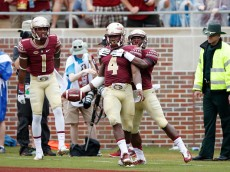 TALLAHASSEE, FL - SEPTEMBER 12: Dalvin Cook #4 of the Florida State Seminoles celebrates with teammates after running for a 74-yard touchdown against the South Florida Bulls in the first quarter at Doak Campbell Stadium on September 12, 2015 in Tallahassee, Florida. (Photo by Joe Robbins/Getty Images)