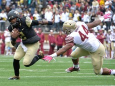 WINSTON SALEM, NC - OCTOBER 03: Kendall Hinton #2 of the Wake Forest Demon Deacons evades DeMarcus Walker #44 of the Florida State Seminoles during their game at BB&T Field on October 3, 2015 in Winston Salem, North Carolina.  (Photo by Grant Halverson/Getty Images)