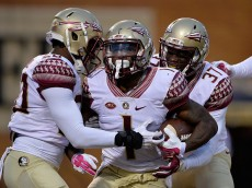 WINSTON SALEM, NC - OCTOBER 03:  Teammates congratulate Tyler Hunter #1 of the Florida State Seminoles after his interception in the end zone during the final minute of their game against the Wake Forest Demon Deacons at BB&T Field on October 3, 2015 in Winston Salem, North Carolina. Florida State won 24-16.  (Photo by Grant Halverson/Getty Images)