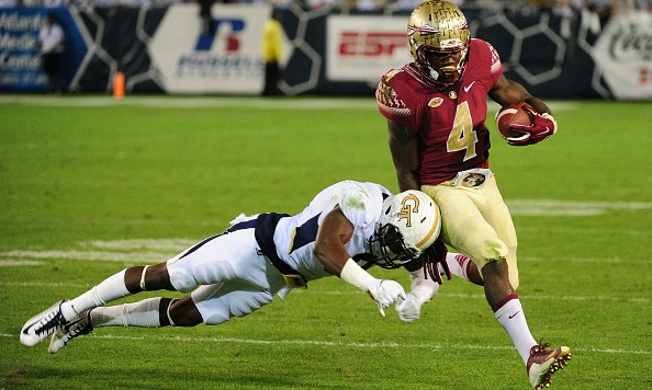 ATLANTA, GA - OCTOBER 24: Dalvin Cook #4 of the Florida State Seminoles evades the tackle attempt by Step Durham #8 of the Georgia Tech Yellow Jackets on October 24, 2015 at Bobby Dodd Stadium in Atlanta, Georgia. Photo by Scott Cunningham/Getty Images)