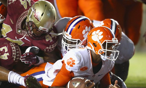 TALLAHASSEE, FL - SEPTEMBER 20:  Deshaun Watson #4 of the Clemson Tigers scores a touchdown against the Florida State Seminoles in the fourth quarter at Doak Campbell Stadium on September 20, 2014 in Tallahassee, Florida.  (Photo by Ronald Martinez/Getty Images)