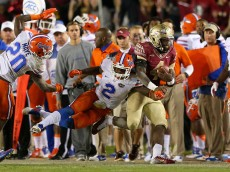 TALLAHASSEE, FL - NOVEMBER 29:  Dalvin Cook #4 of the Florida State Seminoles is tackled by Jabari Gorman  #2 of the Florida Gators  during a game  at Doak Campbell Stadium on November 29, 2014 in Tallahassee, Florida.  (Photo by Mike Ehrmann/Getty Images)
