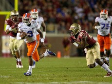 TALLAHASSEE, FL - NOVEMBER 29:  Treon Harris #3 of the Florida Gators rushes during a game against the Florida State Seminoles  at Doak Campbell Stadium on November 29, 2014 in Tallahassee, Florida.  (Photo by Mike Ehrmann/Getty Images)