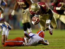 TALLAHASSEE, FL - NOVEMBER 29: Dalvin Cook #4 of the Florida State Seminoles is tackled byVernon Hargreaves III #1 of the Florida Gators  during a game  at Doak Campbell Stadium on November 29, 2014 in Tallahassee, Florida.  (Photo by Mike Ehrmann/Getty Images)