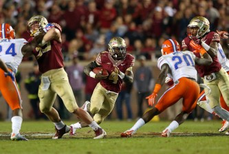 TALLAHASSEE, FL - NOVEMBER 29:  Dalvin Cook #4 of the Florida State Seminoles rushes during a game against the Florida Gators  at Doak Campbell Stadium on November 29, 2014 in Tallahassee, Florida.  (Photo by Mike Ehrmann/Getty Images)