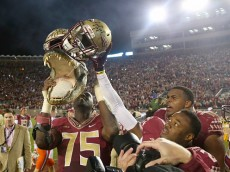 TALLAHASSEE, FL - NOVEMBER 29:  The Florida State Seminoles hold up a gator head after defeating the Florida Gators  at Doak Campbell Stadium on November 29, 2014 in Tallahassee, Florida.  (Photo by Mike Ehrmann/Getty Images)