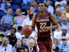 GREENSBORO, NC - MARCH 11: Xavier Rathan-Mayes #22 of the Florida State Seminoles moves the ball against the Clemson Tigers during a second round game of the ACC basketball tournament at Greensboro Coliseum on March 11, 2015 in Greensboro, North Carolina. (Photo by Grant Halverson/Getty Images)