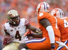 CLEMSON, SC - NOVEMBER 07:  Dalvin Cook #4 of the Florida State Seminoles runs with the ball against the Clemson Tigers during their game at Memorial Stadium on November 7, 2015 in Clemson, South Carolina.  (Photo by Streeter Lecka/Getty Images)