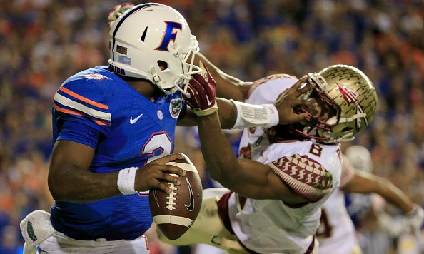 GAINESVILLE, FL - NOVEMBER 28:  Jalen Ramsey #8 of the Florida State Seminoles attempts to tackle Treon Harris #3 of the Florida Gators during the game at Ben Hill Griffin Stadium on November 28, 2015 in Gainesville, Florida.  (Photo by Sam Greenwood/Getty Images)