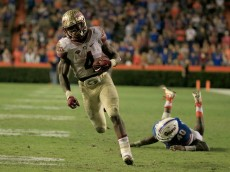 GAINESVILLE, FL - NOVEMBER 28:  Dalvin Cook #4 of the Florida State Seminoles runs for a touchdown during the game against the Florida Gators at Ben Hill Griffin Stadium on November 28, 2015 in Gainesville, Florida.  (Photo by Sam Greenwood/Getty Images)