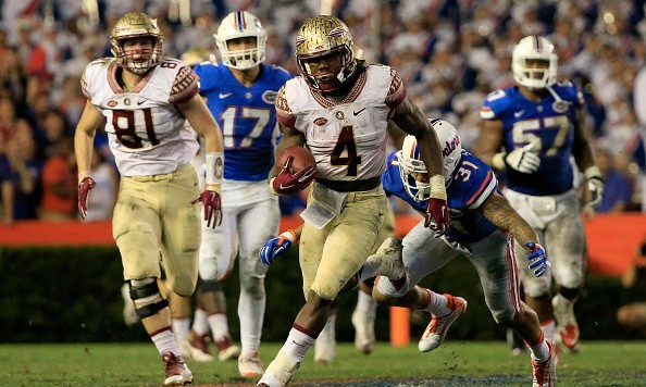 GAINESVILLE, FL - NOVEMBER 28:  Dalvin Cook #4 of the Florida State Seminoles runs for yardage during the game against the Florida Gators at Ben Hill Griffin Stadium on November 28, 2015 in Gainesville, Florida.  (Photo by Sam Greenwood/Getty Images)