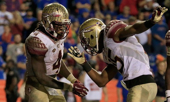 GAINESVILLE, FL - NOVEMBER 28:  Dalvin Cook #4 and Travis Rudolph #15 of the Florida State celebrate a touchdown during the game against the Florida Gators at Ben Hill Griffin Stadium on November 28, 2015 in Gainesville, Florida.  (Photo by Sam Greenwood/Getty Images)