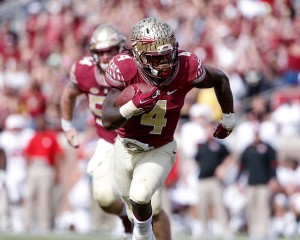 TALLAHASSEE, FL - NOVEMBER 14: Runningback Dalvin Cook #4 of the Florida State Seminoles on a running play during the game against the North Carolina State Wolfpack at Doak Campbell Stadium on Bobby Bowden Field on November 14, 2015 in Tallahassee, Florida. Florida State defeated NC State 34 to 17. (Photo by Don Juan Moore/Getty Images) *** Local Caption *** Dalvin Cook