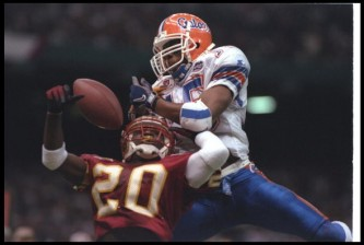 2 Jan 1997:  James Colzie of the Florida State Seminoles (left) and Florida Gators wide receiver Reidel Anthony fight for the ball during the Nokia Sugar Bowl at the Superdome in New Orleans, Louisiana.  Florida won the game, 52-20. Mandatory Credit: Doug