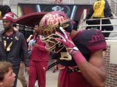 FSU's Jalen Ramsey chats with a Seminoles fans before Saturday's game against Chattanooga in Doak Campbell Stadium on Saturday, Nov. 21, 2015. (Photo: Safid Deen/Democrat)