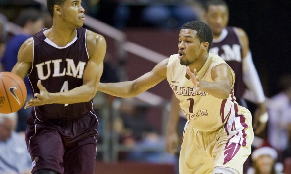 TALLAHASSEE, FL - DECEMBER 17: Devon Bookert #1 of the Florida State Seminoles defends against R.J. McCray #4 of the Louisiana-Monroe Warhawks during the game at the Donald L. Tucker Center on December 17, 2012 in Tallahassee, Florida. Florida State won 63-48. (Photo by Jeff Gammons/Getty Images)