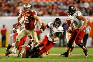 MIAMI GARDENS, FL - JANUARY 01:  Quarterback Jordan Lynch #6 of the Northern Illinois Huskies is tackled by the Florida State Seminoles during the Discover Orange Bowl at Sun Life Stadium on January 1, 2013 in Miami Gardens, Florida.  (Photo by Chris Trotman/Getty Images)