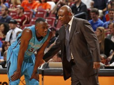 SUNRISE, FL - DECEMBER 21: Head Coach Leonard Hamilton talks to Montay Brandon #32 of the Florida State Seminoles during a break in action against the Massachusetts Minutemen during the MetroPCS Orange Bowl Basketball Classic on December 21, 2013 at the BB&T Center in Sunrise, Florida. Florida State defeated Massachusetts 60-55. (Photo by Joel Auerbach/Getty Images)