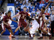GREENSBORO, NC - MARCH 11:  Xavier Rathan-Mayes #22 of the Florida State Seminoles defends a drive by Rod Hall #12 of the Clemson Tigers during a second round game of the ACC basketball tournament at Greensboro Coliseum on March 11, 2015 in Greensboro, North Carolina.  (Photo by Grant Halverson/Getty Images)