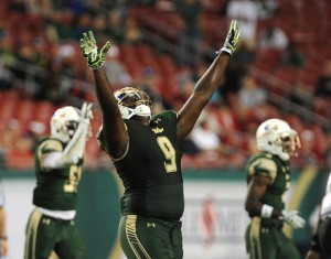 TAMPA, FL - NOVEMBER 14:Defensive end Demetrius Hill #9 of the South Florida Bulls celebrates a defensive play against the Temple Owls in the second half at Raymond James Stadium on November 14, 2015 in Tampa, Florida. South Florida beat the Temple Owls 44-23. (Photo by Cliff McBride/Getty Images) *** Local Caption *** Demetrius Hill