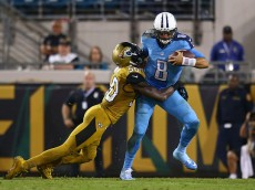 JACKSONVILLE, FL - NOVEMBER 19: Marcus Mariota #8 of the Tennessee Titans is sacked by Telvin Smith #50 of the Jacksonville Jaguars during the second half of the game at EverBank Field on November 19, 2015 in Jacksonville, Florida.  (Photo by Rob Foldy/Getty Images)