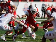 HOUSTON, TX - DECEMBER 05:  Greg Ward Jr. #1 of the Houston Cougars rushes with the ball in the first half against the Temple Owls during the AAC Championship game at TDECU Stadium on December 5, 2015 in Houston, Texas.  (Photo by Bob Levey/Getty Images)
