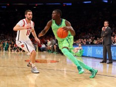 NEW YORK, NY - MARCH 15:  Jerian Grant #22 of the Notre Dame Fighting Irish drives against Luke Hancock #11 of the Louisville Cardinals during the semifinals of the Big East Men's Basketball Tournament at Madison Square Garden on March 15, 2013 in New York City.  (Photo by Al Bello/Getty Images)