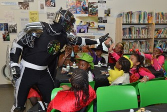 NEW YORK, NY - OCTOBER 28: Nets Super Hero BrooklyKnight hosts a Halloween Monster Mash for 50 kids at The Brooklyn Children's Museum on October 28, 2013 in New York City.  (Photo by Slaven Vlasic/Getty Images)