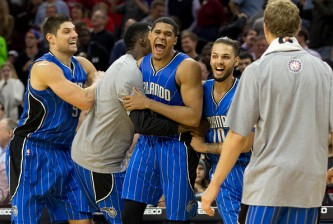 PHILADELPHIA, PA - NOVEMBER 5: Tobias Harris #12 of the Orlando Magic reacts with Nikola Vucevic #9 and Evan Fournier #10 after Harris made the game winning jump shot at the buzzer to defeat the Philadelphia 76ers 91-89 on November 5, 2014 at the Wells Fargo Center in Philadelphia, Pennsylvania. (Photo by Mitchell Leff/Getty Images)