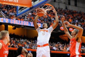 SYRACUSE, NY - DECEMBER 31:  Chris McCullough #5 of the Syracuse Orange dunks the ball against the Cornell Big Red during the second half at the Carrier Dome on December 31, 2014 in Syracuse, New York.  Syracuse defeated Cornell 61-44.  (Photo by Rich Barnes/Getty Images)