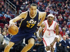 HOUSTON, TX - JANUARY 10:  Rudy Gobert #27 of the Utah Jazz drives with the basketball in front of Jason Terry #31 of the Houston Rockets during their game at the Toyota Center on January 10, 2015 in Houston, Texas.  NOTE TO USER: User expressly acknowledges and agrees that, by downloading and/or using this photograph, user is consenting to the terms and conditions of the Getty Images License Agreement.  (Photo by Scott Halleran/Getty Images)