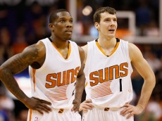 PHOENIX, AZ - JANUARY 21:  (R-L) Goran Dragic #1, and Eric Bledsoe #2 of the Phoenix Suns look on during a break from the NBA game against the Portland Trail Blazers at US Airways Center on January 21, 2015 in Phoenix, Arizona. The Suns defeated the Trail Blazers 118-113. NOTE TO USER: User expressly acknowledges and agrees that, by downloading and or using this photograph, User is consenting to the terms and conditions of the Getty Images License Agreement.  (Photo by Christian Petersen/Getty Images)
