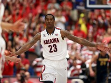TUCSON, AZ - FEBRUARY 26:  Rondae Hollis-Jefferson #23 of the Arizona Wildcats high fives teammates after scoring against the California Golden Bears during the first half of the college basketball game at McKale Center on February 26, 2014 in Tucson, Arizona.  (Photo by Christian Petersen/Getty Images)