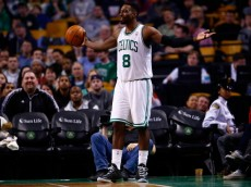 BOSTON, MA - MARCH 30: Jeff Green #8 of the Boston Celtics reacts following a foul call in the second half against the Chicago Bulls during the game at TD Garden on March 30, 2014 in Boston, Massachusetts. NOTE TO USER: User expressly acknowledges and agrees that, by downloading and or using this photograph, User is consenting to the terms and conditions of the Getty Images License Agreement.  (Photo by Jared Wickerham/Getty Images)