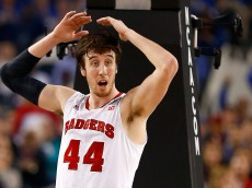 ARLINGTON, TX - APRIL 05:  Frank Kaminsky #44 of the Wisconsin Badgers reacts to a call during the NCAA Men's Final Four Semifinal against the Kentucky Wildcats at AT&T Stadium on April 5, 2014 in Arlington, Texas.  (Photo by Tom Pennington/Getty Images)