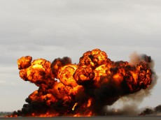 MELBOURNE, AUSTRALIA - MARCH 04:  An explosion goes off during a firefight display during the Avalon Air Show on March 4, 2011 in Melbourne, Australia.  (Photo by Mark Dadswell/Getty Images)