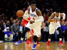 Nov 3, 2014; Philadelphia, PA, USA; Philadelphia 76ers forward Nerlens Noel (4) brings the ball up court against the Houston Rockets at the Wells Fargo Center. The Rockets defeated the 76ers 104-93. Mandatory Credit: Bill Streicher-USA TODAY Sports (Bill Streicher)
