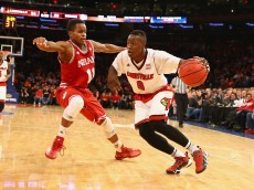 NEW YORK, NY - DECEMBER 09:  Terry Rozier #0 of the Louisville Cardinals dribbles against Yogi Ferrell #11 of the Indiana Hoosiers during their game at the Jimmy V Classic in Madison Square Garden on December 9, 2014 in New York City.  (Photo by Al Bello/Getty Images)