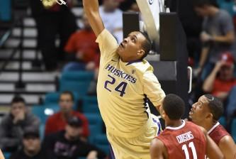LAS VEGAS, NV - DECEMBER 20:  Robert Upshaw #24 of the Washington Huskies is fouled as he dunks against the Oklahoma Sooners during the 2014 MGM Grand Showcase basketball event at the MGM Grand Garden Arena on December 20, 2014 in Las Vegas, Nevada. Washington won 69-67.  (Photo by Ethan Miller/Getty Images)