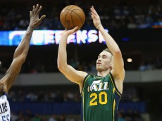 DALLAS, TX - FEBRUARY 11:  Gordon Hayward #20 of the Utah Jazz takes a shot against Bernard James #55 of the Dallas Mavericks at American Airlines Center on February 11, 2015 in Dallas, Texas.  NOTE TO USER: User expressly acknowledges and agrees that, by downloading and or using this photograph, User is consenting to the terms and conditions of the Getty Images License Agreement.  (Photo by Ronald Martinez/Getty Images)