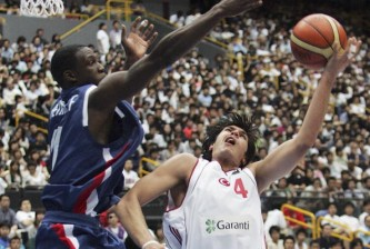 SAITAMA, JAPAN - SEPTEMBER 2:  Florent Pietrus #11 of France tries to block the shot of Cenk Akyol #4 of Turkey during the 2006 FIBA World Championship Classification Round on September 2, 2006 in Saitama, Japan. The Championship takes place from August 19 to September 3 in Japan. (Photo by Junko Kimura/Getty Images)