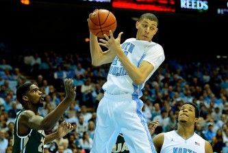 CHAPEL HILL, NC - DECEMBER 27:  Justin Jackson #44 of the North Carolina Tar Heel pulls down a rebound against the UAB Blazers during their game at the Dean Smith Center on December 27, 2014 in Chapel Hill, North Carolina.  (Photo by Grant Halverson/Getty Images)
