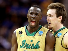CLEVELAND, OH - MARCH 26:  Jerian Grant #22 of the Notre Dame Fighting Irish celebrates with Pat Connaughton #24 after a play in the second half against the Wichita State Shockers during the Midwest Regional semifinal of the 2015 NCAA Men's Basketball Tournament at Quicken Loans Arena on March 26, 2015 in Cleveland, Ohio.  (Photo by Andy Lyons/Getty Images)