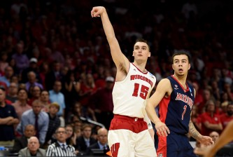 LOS ANGELES, CA - MARCH 28:  Sam Dekker #15 of the Wisconsin Badgers shoots a three-pointer alongside Gabe York #1 of the Arizona Wildcats in the second half during the West Regional Final of the 2015 NCAA Men's Basketball Tournament at Staples Center on March 28, 2015 in Los Angeles, California.  (Photo by Harry How/Getty Images)