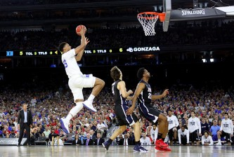 HOUSTON, TX - MARCH 29: Jahlil Okafor #15 of the Duke Blue Devils goes for a layup against the Gonzaga Bulldogs during the South Regional Final of the 2015 NCAA Men's Basketball Tournament at NRG Stadium on March 29, 2015 in Houston, Texas.  (Photo by Ronald Martinez/Getty Images)