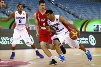 DUBAI, UNITED ARAB EMIRATES - AUGUST 14: Jamal Murray  of Canada controls the ball against Slobodan Jovanovic of Serbia during the FIBA U17 World Championships Quarter-Final match between  Canada and Serbia at the Hamdan Sports Complex on August 14, 2014 in Dubai, United Arab Emirates.  (Photo by Francois Nel/Getty Images)