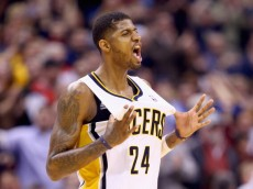 INDIANAPOLIS, IN - FEBRUARY 07:  Paul George#24 of the Indiana Pacers  celebrates during overtime in the118-113 win over the Portland Trailblazers  at Bankers Life Fieldhouse on February 7, 2014 in Indianapolis, Indiana.  NOTE TO USER: User expressly acknowledges and agrees that, by downloading and or using this Photograph, user is consenting to the terms and condition of the Getty Images License Agreement.  (Photo by Andy Lyons/Getty Images)