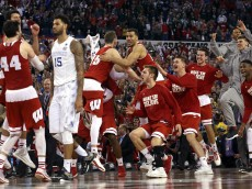 INDIANAPOLIS, IN - APRIL 04:  Willie Cauley-Stein #15 of the Kentucky Wildcats walks off the court as the Wisconsin Badgers celebrate during the NCAA Men's Final Four Semifinal at Lucas Oil Stadium on April 4, 2015 in Indianapolis, Indiana. Wisconsin defeated Kentucky 71-64.  (Photo by Andy Lyons/Getty Images)